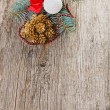 Stock Photo: Christmas ball, red bow and pine branch over wood background