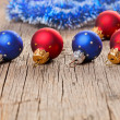 Small New Year decoration balls on old wooden background - Stock Photo
