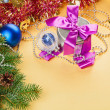 New Year present and decorations on yellow background — Стоковая фотография