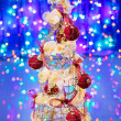 New Year tree decorated on blue sparkling background — Stock Photo