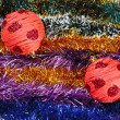 Christmas tinsel multicolored decoration with red balls — Foto Stock