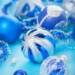 Christmas decoration balls on blue background, closeup — Stock Photo #13476991