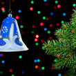 New Year decorations bell on dark multicolor circles bokeh backg - Стоковая фотография
