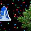 New Year decorations bell on dark multicolor circles bokeh backg - Foto Stock
