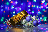 New Year decorations composition with golden fancy box on bokeh — Stock Photo