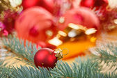 Red decoration ball with spruce branch macro — Stock Photo