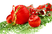 Red Christmas balls composition on green thuja branch — Stock Photo