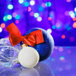 Stock Photo: New Year decoration ball toys with red ribbon bow on circles bok