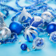 Christmas decorations still life in blue tones — Stock Photo #13678356