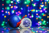 New Year decoration ball toys on circles bokeh background — Stock Photo