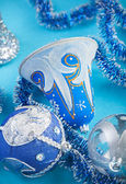 Christmas bell and decorations on blue background — Stock Photo
