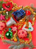 Many different Christmas decorations on red background — Stock Photo