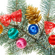 Multicolored Christmas balls, bows and cone on spruce branch, is — Photo