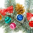 Multicolored Christmas balls, bows and cone on spruce branch, is - Stockfoto