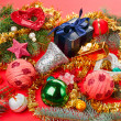 Many different Christmas decorations on red background - Stock Photo