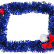Christmas decoration frame with blue tinsel — Stock Photo #14426531