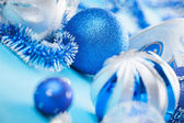 New Year decorations ball on blue blurred background — Stock Photo