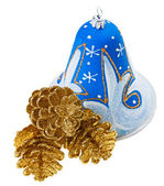 Blue christmas decoration bell and golden fircones, isolated on — Stock Photo