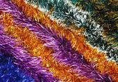 рождественская мишура разноцветные украшения заложен по диагонали — Стоковое фото