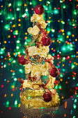 Christmas tree decorated on green sparkling background — Stock Photo