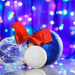 New Year decoration ball toys with red ribbon bow on circles bok — Stock Photo #15311455
