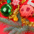 Foto Stock: Christmas decorations on red background