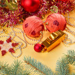 Christmas balls and decorations on golden background — Stock Photo