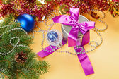 Christmas present and decorations on yellow background — Stock Photo