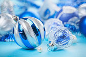 Two Christmas decor balls on blue background with shallow depth — Stok fotoğraf
