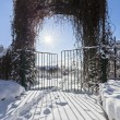 Winter garden entrance with quickset gate, bright sun and beauti - Stok fotoğraf