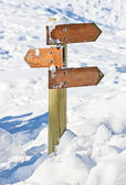 Old snow covered wooden signpost (index arrowhead) — Stock Photo