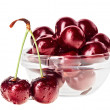 Still life with pair of red wet cherry fruit on stem and glass b — Stock Photo #18735545