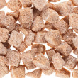 Many brown lump cane sugar cubes , food background - Foto Stock