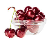 Still life with pair of red wet cherry fruit on stem and glass b — Stock Photo