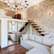 Stock Photo: Modern style two-high living-room interior with staircase and st