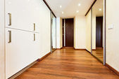 Modern minimalism style corridor interior with sliding-door mirr — Stock Photo