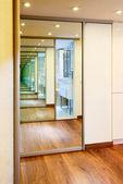 Sliding-door mirror wardrobe in modern hall interior with infini — Stock Photo