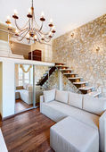 Modern style two-high living-room interior with staircase and st — Stock Photo