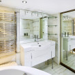 Wash stand with mirror in modern white bathroom interior — Stock Photo