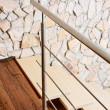 Modern style staircase ashlar wall and, interior detail — Stock Photo