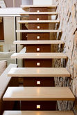 Modern style staircase and ashlar wall, interior detail — Stock Photo
