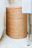 Wicker clothes basket in the bathroom, interior detail — Stock Photo