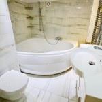 Modern white bathroom interior with jaccusi — Stock Photo