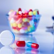 Pills and tablets macro still life on white blue, medical therap — Stock Photo
