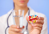 Pills, tablets and drugs heap in doctor hand, closeup view — Stock Photo