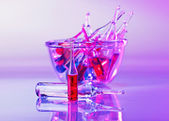 Medical ampoules still life in vivid violet colors — Stock Photo