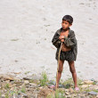KALANKI - APRIL 2: Portrait of Nepalese herder boy with a rod — Stock Photo
