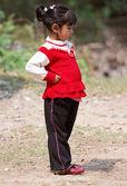 KALANKI - APRIL 2: Portrait of Nepalese girl in red dress — Stock Photo