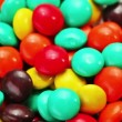 Stock Video: Multicolor bonbon sweets (ball candies) rotating food background