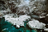 Mountain river with stones infrared (IR) landscape — Stock Photo